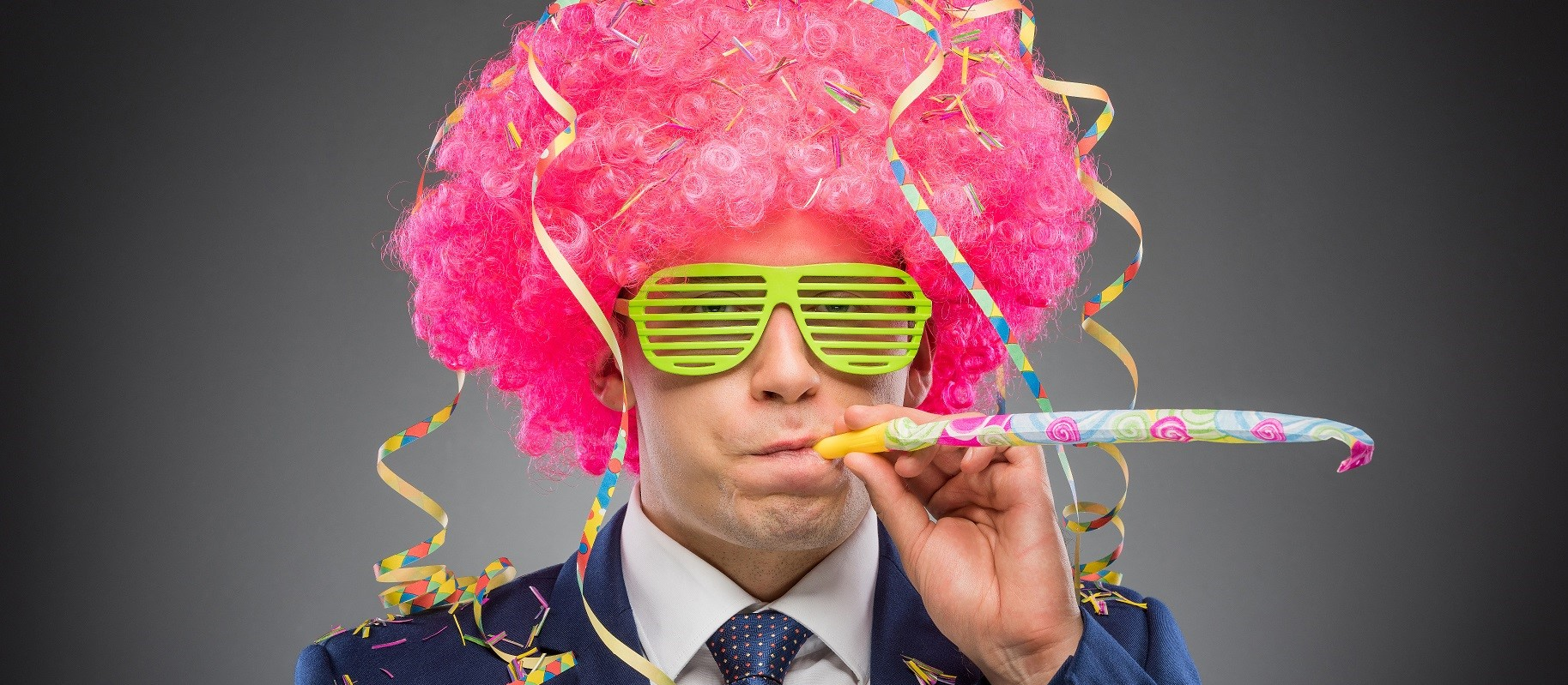 Pink business man in wig poses for photobooth picture